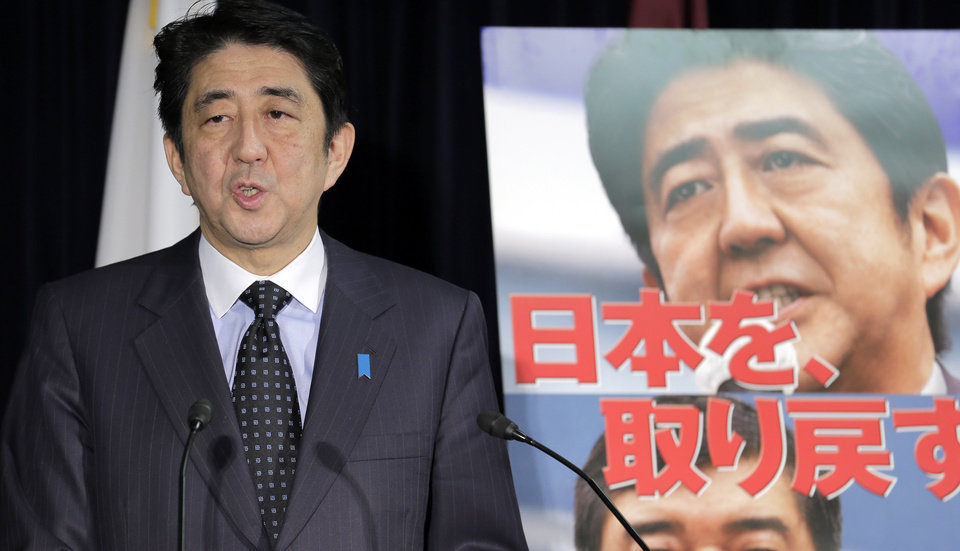 Photo -   Japan's largest opposition Liberal Democratic Party leader Shinzo Abe, standing by the party poster reading: