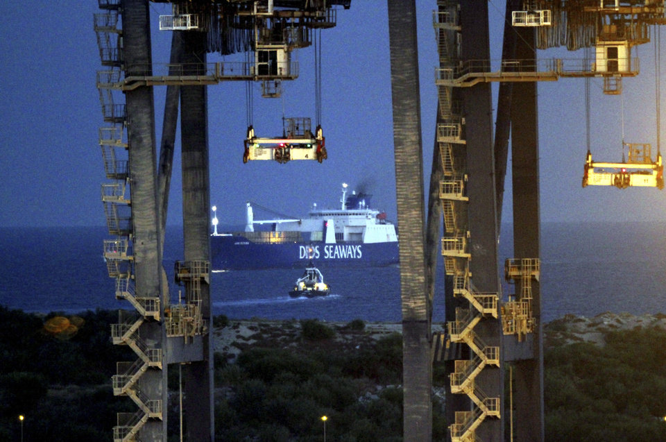 Photo - The Danish cargo ship Ark Futura arrives at Gioia Tauro port, southern Italy, Wednesday, July 2, 2014. Syria's acknowledged stockpile of chemical weapons has been handed over to Western governments for destruction. About 1,300 tons of chemical weapons are currently on the Ark Futura and are expected be transferred to the U.S.-owned MV Cape Ray at Gioia Tauro. The Cape Ray has been fitted with two machines designed to neutralize the most toxic chemicals, including mustard gas and the raw materials for sarin nerve gas, that were removed from Syria as part of the international effort to destroy its chemical weapons. The most dangerous chemical weapons will be transferred from the Danish vessel Ark Futura to the Cape Ray, which will move into international waters for the destruction. Other material will be taken to toxic wastes sites in various countries for disposal. (AP Photo/Adriana Sapone)