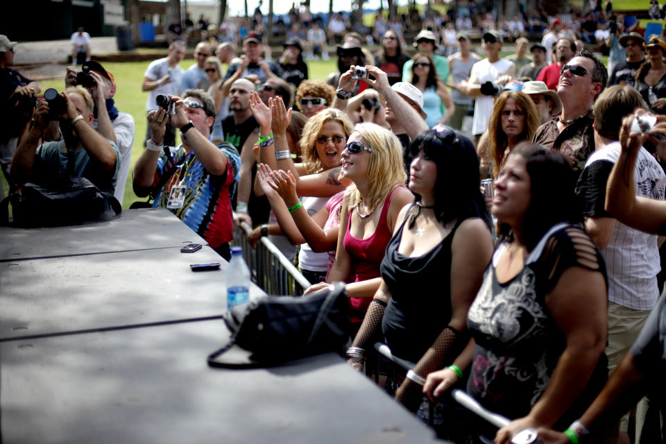 Fans watch the band Axe during the Rock-N-America Music Festival at the Zoo Amphitheater in Oklahoma City, Friday, July 23, 2010.  Photo by Bryan Terry, The Oklahoman