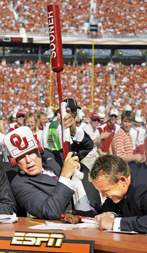College GameDay's Kirk Herbstreit, right, laughs after Lee Corso fired off a RUF/NEKS shotgun when he picked OU to win against Texas before the Sooners' loss to the Longhorns on Oct. 11.  PHOTO BY NATE BILLINGS, THE OKLAHOMAN