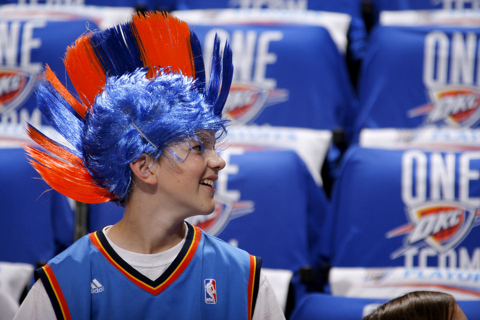Photo - Jackson Johnson, 13, of Oklahoma City waits for Game 1 in the second round of the NBA playoffs between the Oklahoma City Thunder and L.A. Lakers at Chesapeake Energy Arena in Oklahoma City, Monday, May 14, 2012. Photo by Bryan Terry, The Oklahoman