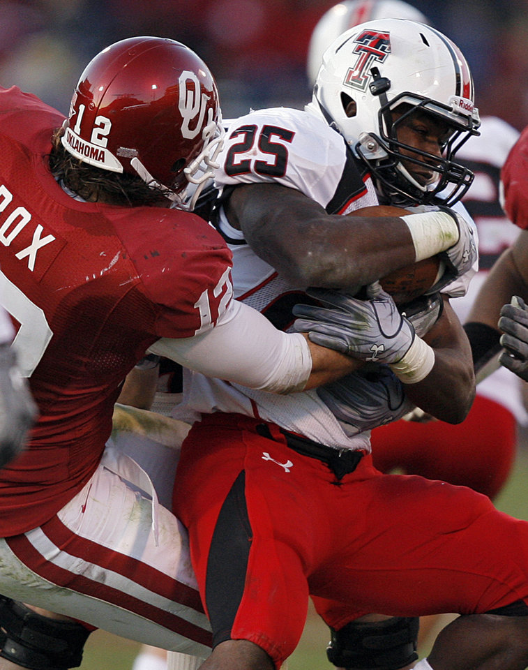 Photo - Oklahoma's Austin Box (12) brings down Texas Tech's Baron Batch (25) during the second half of the college football game between the University of Oklahoma Sooners (OU) and the Texas Tech Red Raiders (TTU) at the Gaylord Family Memorial Stadium on Saturday, Nov. 13, 2010, in Norman, Okla.  Photo by Chris Landsberger, The Oklahoman