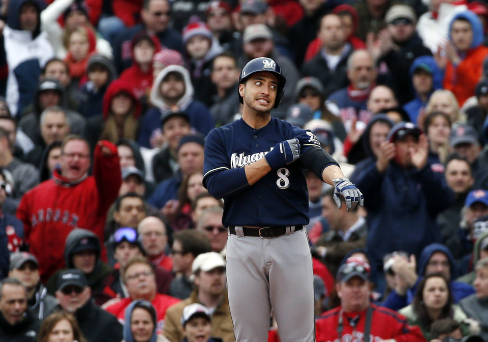 Photo - Milwaukee Brewers' Ryan Braun (8) pauses at first base after grounding out in the seventh inning of a baseball game against the Boston Red Sox at Fenway Park in Boston, Friday, April 4, 2014. (AP Photo/Elise Amendola)