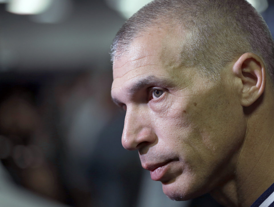 Photo - New York Yankees manager Joe Girardi answers a question about shortstop Derek Jeter after a news conference Wednesday, Feb. 19, 2014, in Tampa, Fla. Jeter has announced he will retire at the end of the 2014 season. (AP Photo/Chris O'Meara)