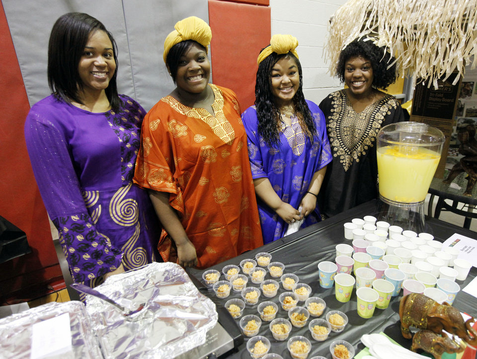 Photo - Representing the Congo, from left, Kenasia Drakes, Bailey Washington, Alaynah Cornish and Marriana Hurd show the colorful clothing of the area during the Global Festival at Carl Albert High School in Midwest City.