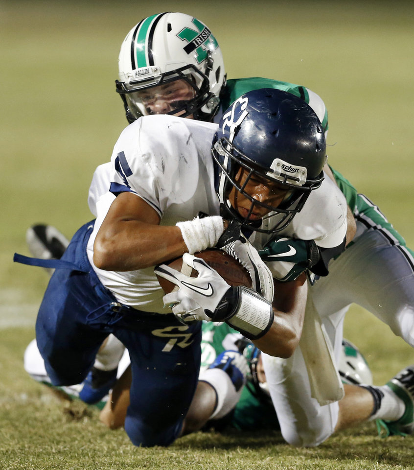 Photo - McGuinness' Bradley Fritch, behind, brings down receiver Justin Brown after a catch as the El Reno Indians play the Bishop McGuinness Fighting Irish in high school football on Friday, Sept. 21, 2012 in Oklahoma City, Okla.  Photo by Steve Sisney, The Oklahoman