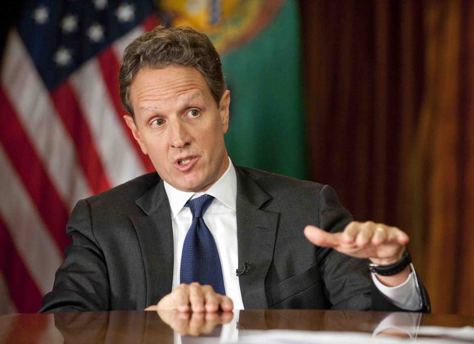 Photo - This Nov. 30, 2012, photo provided by CBS News shows Treasury Secretary Timothy Geithner answering questions about averting the