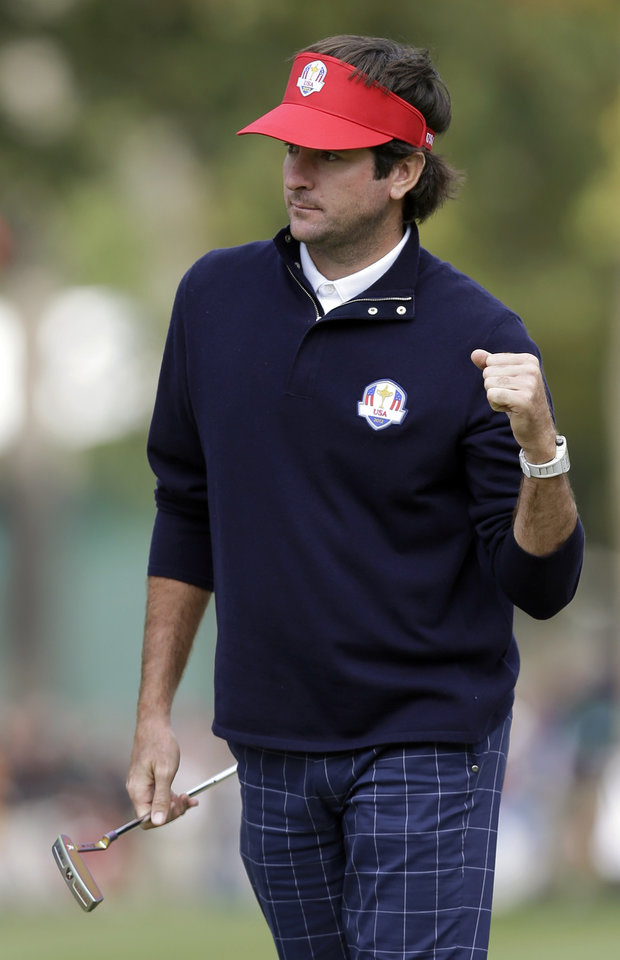 Photo -   USA's Bubba Watson reacts after making a birdie putt on the third hole during a four-ball match at the Ryder Cup PGA golf tournament Friday, Sept. 28, 2012, at the Medinah Country Club in Medinah, Ill. (AP Photo/David J. Phillip)