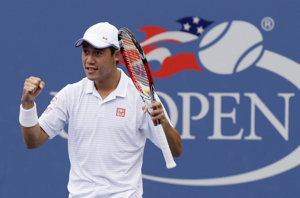 Photo - Kei Nishikori, of Japan, reacts after defeating Leonardo Mayer, of Argentina, during the third round of the 2014 U.S. Open tennis tournament, Saturday, Aug. 30, 2014, in New York. (AP Photo/Seth Wenig)