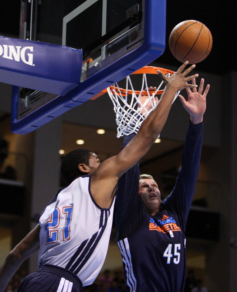 Photo - OKC small forward Hollis Thompson (21) scores under the hoop past center Cole Aldrich (45) during the Blue-White scrimmage at the SpiritBank Event Center, on Thursday, Oct. 18, 2012. CORY YOUNG/Tulsa World