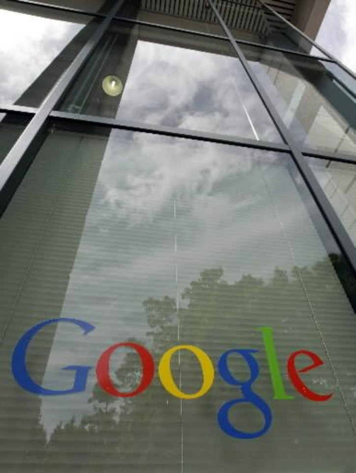 Photo - A Google logo is displayed at the headquarters in Mountain View, Calif., Thursday, April 12, 2012. Google Inc. said Thursday that it earned $2.89 billion, or $8.75 per share, in the first quarter. That's up from $1.8 billion, or $5.51 per share, a year earlier. (AP Photo/Paul Sakuma)