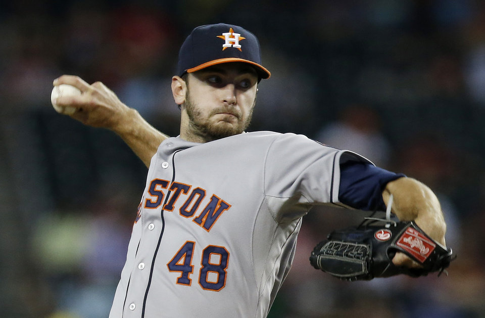 Photo - Houston Astros' Jarred Cosart throws against the Arizona Diamondbacks during the first inning of a baseball game on Monday, June 9, 2014, in Phoenix. (AP Photo/Ross D. Franklin)
