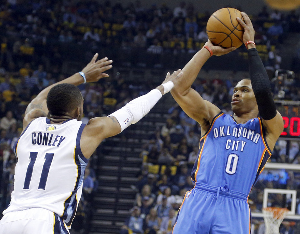 Photo - Oklahoma City's Russell Westbrook (0) shoots as Memphis' Mike Conley (11) defends during Game 6  in the first round of the NBA playoffs between the Oklahoma City Thunder and the Memphis Grizzlies at FedExForum in Memphis, Tenn., Thursday, May 1, 2014. Photo by Bryan Terry, The Oklahoman