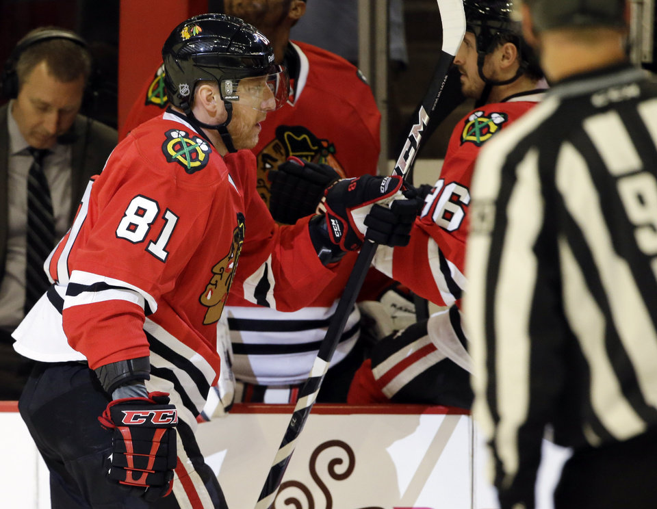 Chicago Blackhawks' Marian Hossa (81) celebrates with teammates after scoring a goal during the first period of Game 1 of an NHL hockey playoffs Western Conference semifinal against the Detroit Red Wings in Chicago, Wednesday, May 15, 2013. (AP Photo/Nam Y. Huh)