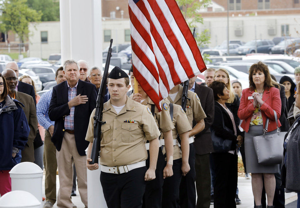 Photo -  The Capitol Hill High School Navy JRROTC presents the colors. [PHOTO BY JIM BECKEL, THE OKLAHOMAN]