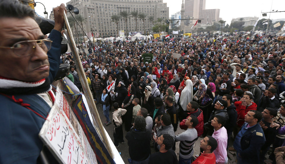 Protesters gather for a demonstration at Tahrir square in Cairo, Egypt, Friday, Dec. 14, 2012. Opposing sides in Egypt\'s political crisis were staging rival rallies on Friday, the final day before voting starts on a contentious draft constitution that has plunged the country into turmoil and deeply divided the nation.(AP Photo/Petr David Josek) ORG XMIT: PJO119