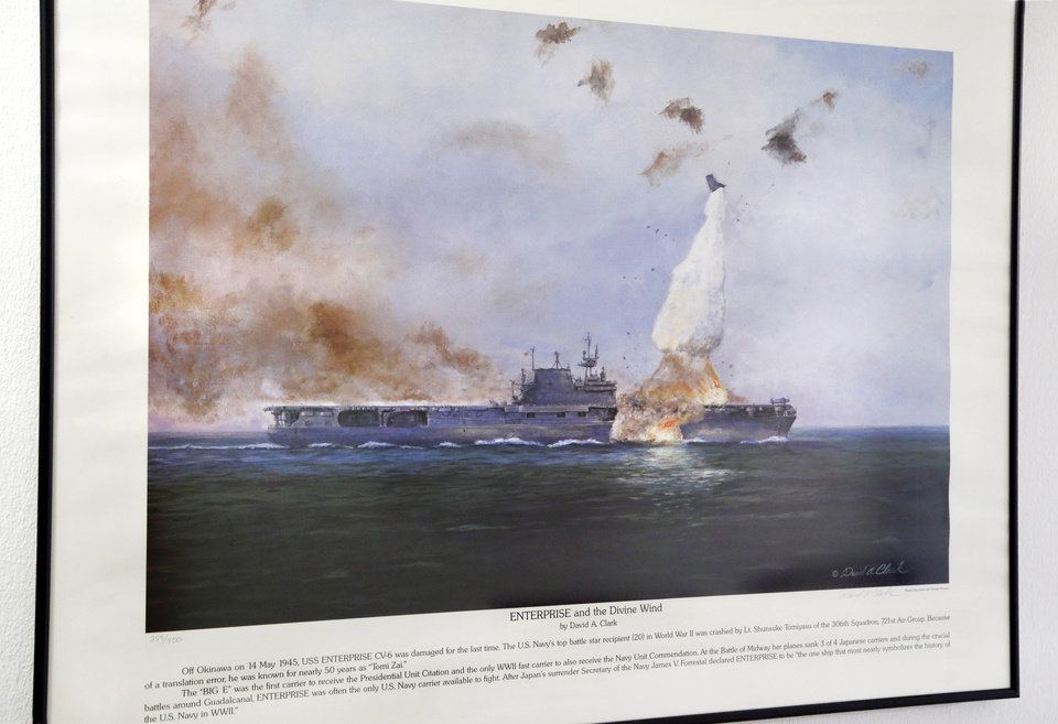 Photo -  A lithograph of the aircraft carrier USS Enterprise under kamikaze attack just off Okinawa hangs in the hallway of Roy Wright's northwest Oklahoma City home. Wright, a Navy veteran of World War II, served aboard the Enterprise. [Photo by Jim Beckel, The Oklahoman]