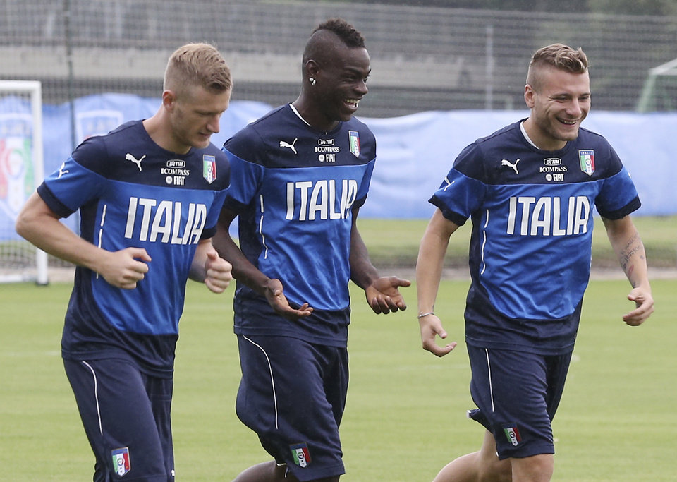 Photo - Italy's Ignazio Abate, from left, Mario Balotelli and Ciro Immobile, right, run side by side during a training session in Mangaratiba, Brazil, Tuesday, June 10, 2014. Italy will play in group D of the Brazil 2014 soccer World Cup. (AP Photo/Antonio Calanni)