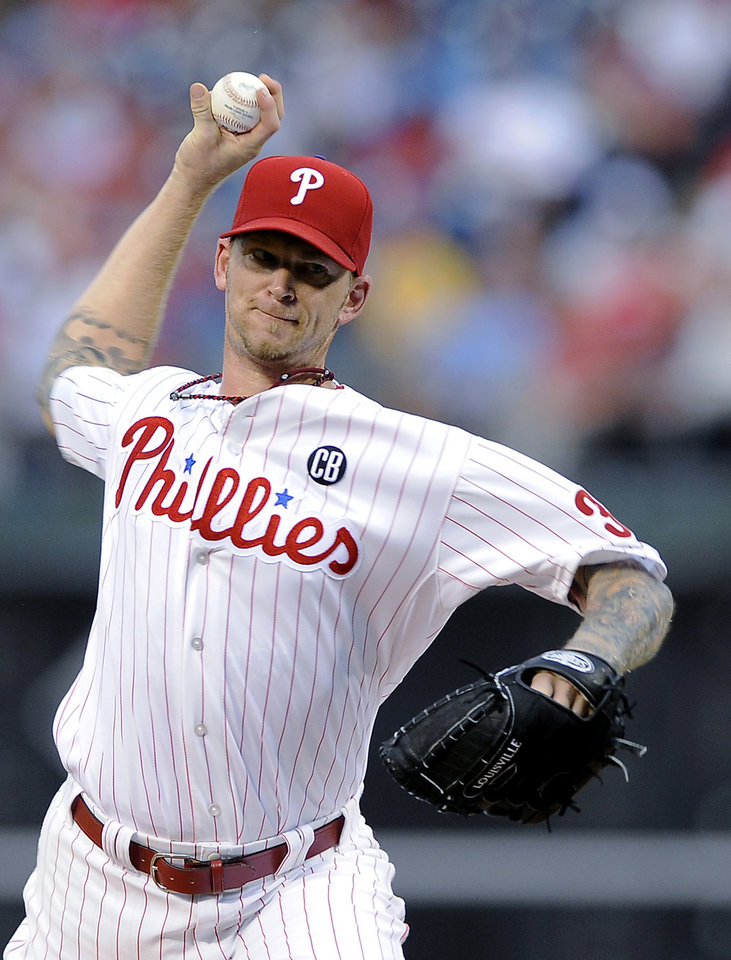 Photo - Philadelphia Phillies starting pitcher A.J. Burnett throws a pitch in the first inning of an interleague baseball game against the Seattle Mariners on Tuesday, Aug. 19, 2014, in Philadelphia. (AP Photo/Michael Perez)
