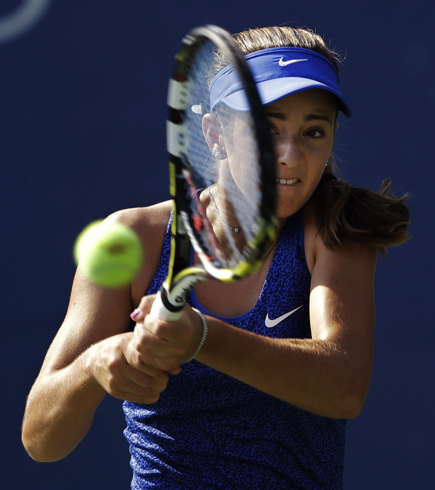 Photo - Catherine Bellis, of the United States, returns a shot against Dominika Cibulkova, of Slovakia, during the first round of the 2014 U.S. Open tennis tournament, Tuesday, Aug. 26, 2014, in New York. (AP Photo/Darron Cummings)
