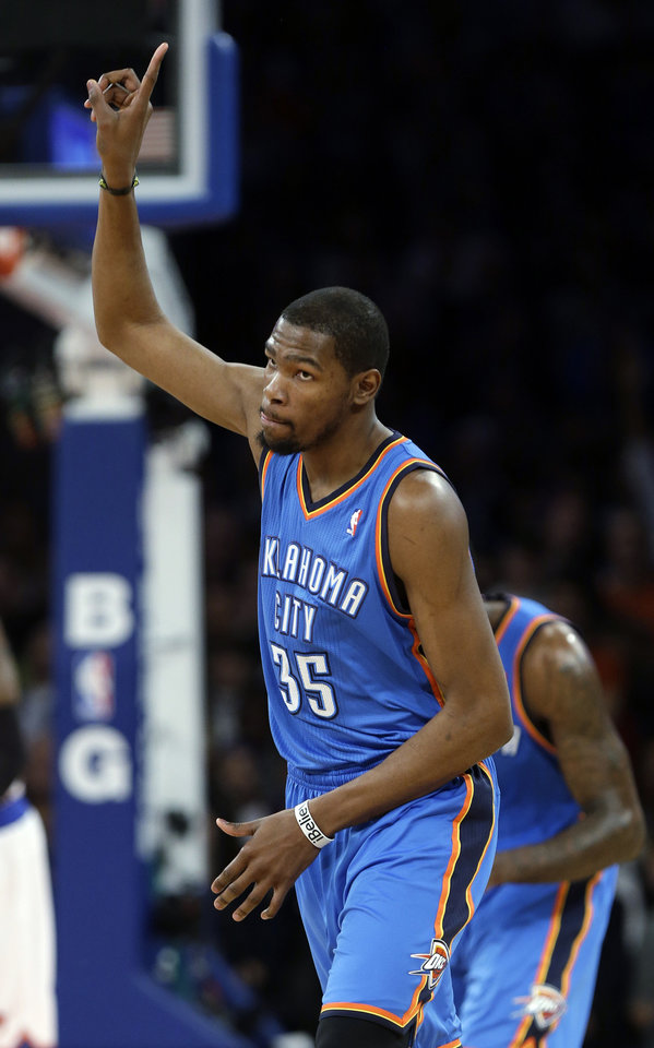 Photo - Oklahoma City Thunder's Kevin Durant (35) reacts after scoring during the first half of an NBA basketball game against the New York Knicks Thursday, March 7, 2013, in New York. (AP Photo/Frank Franklin II)