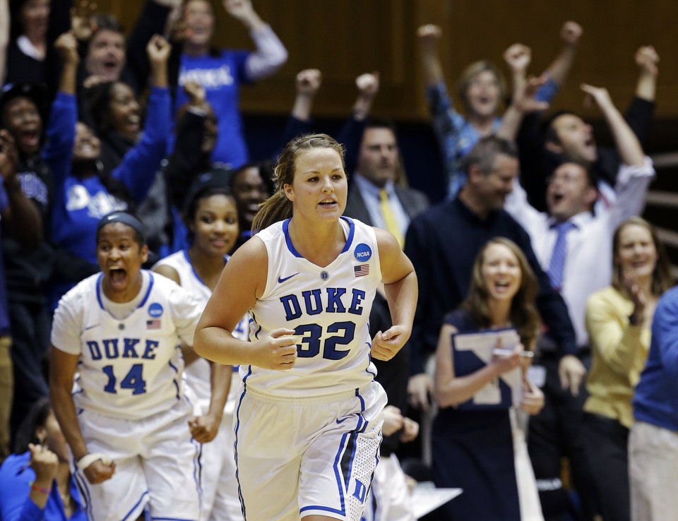 Duke\'s Tricia Liston (32) and Ka\'lia Johnson (14) react following Liston\'s 3-pointer against Oklahoma State during the second half of a second-round game in the women\'s NCAA college basketball tournament in Durham, N.C., Tuesday, March 26, 2013. Duke won 68-59. (AP Photo/Gerry Broome)
