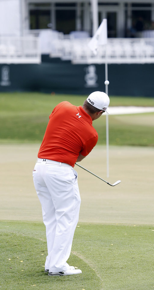 Photo - Daniel Summerhays chips to the ninth green during the first round of the Sanderson Farms Championship golf tournament, Thursday, July 18, 2013 in Madison, Miss. (AP Photo/Rogelio V. Solis)