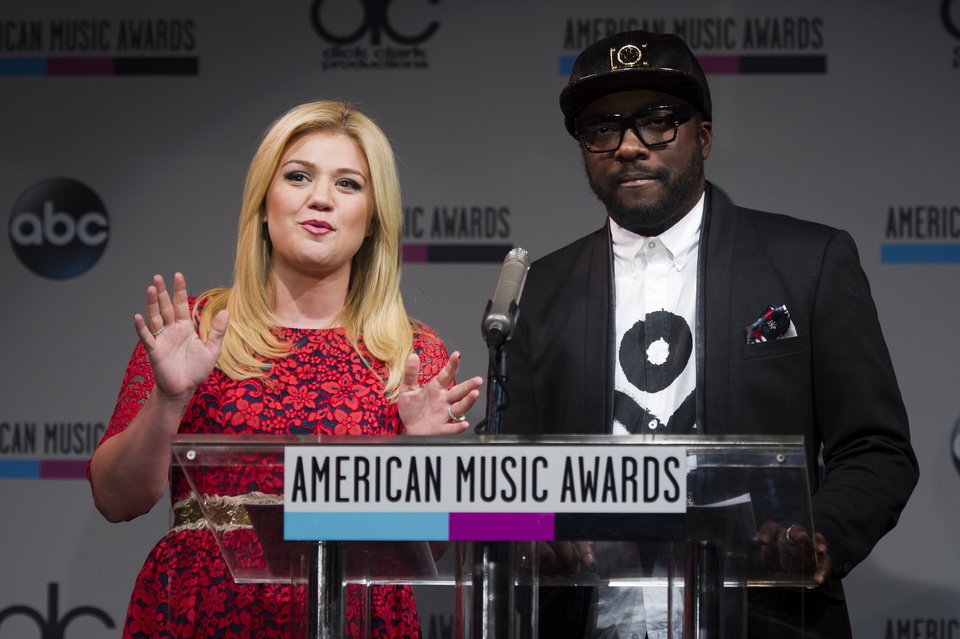 Photo - Kelly Clarkson, left, and will.i.am announce the nominees for the American Music Awards, on Thursday, Oct. 10, 2013 in New York. (Photo by Charles Sykes/Invision/AP)