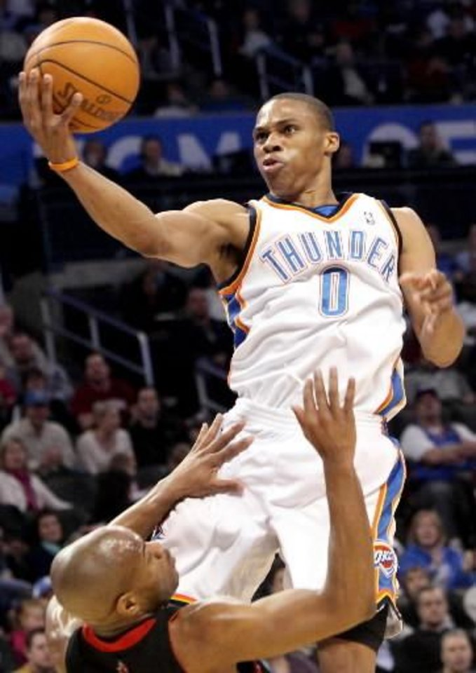 Oklahoma City's  Russell  Westbrook puts up a shot over Toronto's Jarrett Jack during their NBA basketball game at the Ford Center in Oklahoma City on Sunday, Feb. 28, 2010. The Thunder beat the Raptors 119-99. Photo by John Clanton