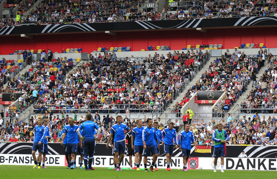 Photo - Geman players take a break  during an open training session ahead of the friendly soccer match between Germany and Argentina on Wednesday in Duesseldorf, Germany, Monday, Sept. 1, 2014. (AP Photo/Frank Augstein)
