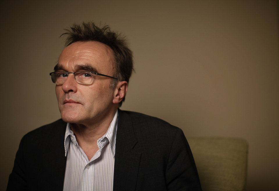 FILE - In this Oct. 25, 2010 file photo, director Danny Boyle poses for photos in Los Angeles. Boyle joined leading British arts figures on Monday, Nov. 5, 2012 to urge a cash-strapped local authority not to sell off a valuable Henry Moore sculpture - arguing it should be erected in London\'s Olympic Park instead. Last month the council announced plans to sell the artwork to offset funding cuts. (AP Photo/Jae C. Hong, File)