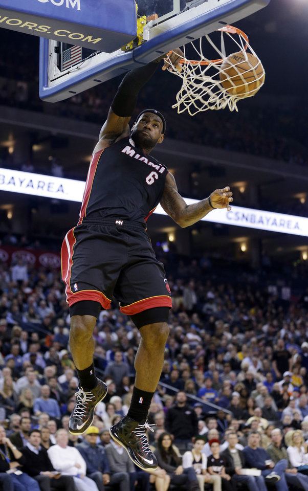 Miami Heat\'s LeBron James (6) dunks against the Golden State Warriors during the first half of an NBA basketball game in Oakland, Calif., Wednesday, Jan. 16, 2013. James on Wednesday became the youngest player in NBA history to score 20,000 points. (AP Photo/Marcio Jose Sanchez)