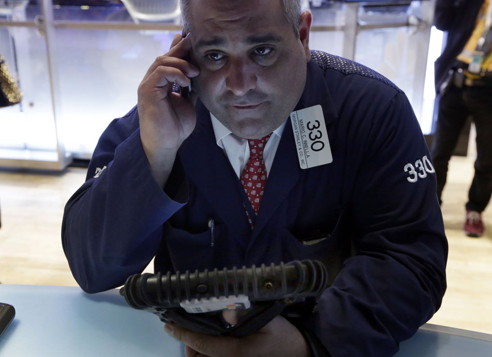 Photo - Trader Mario Innella works on the floor of the New York Stock Exchange Wednesday, April 10, 2013. Stocks are opening higher on Wall Street, a day after the Dow Jones industrial average closed at its second all-time high in a week. (AP Photo/Richard Drew)