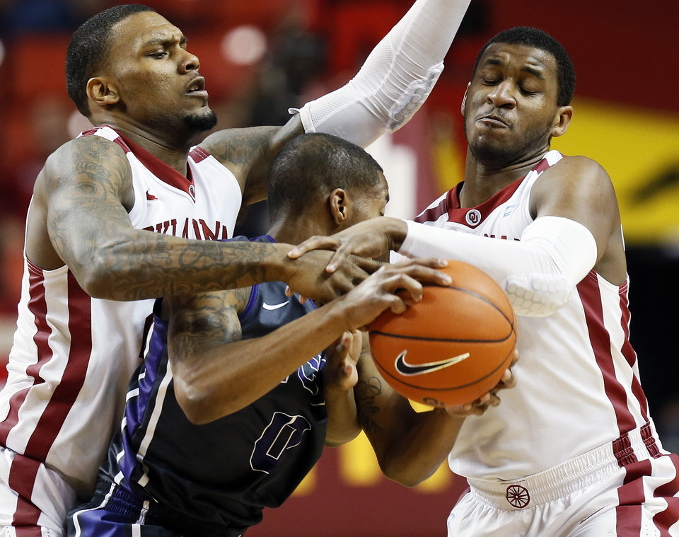 Oklahoma's Romero Osby (24), left, and Steven Pledger (2) pressure TCU's Charles Hill Jr. (0) during an NCAA men's basketball game between the University of Oklahoma (OU) and Texas Christian University (TCU) at the Lloyd Noble Center in Norman, Okla., Monday, Feb. 11, 2013. Photo by Nate Billings, The Oklahoman