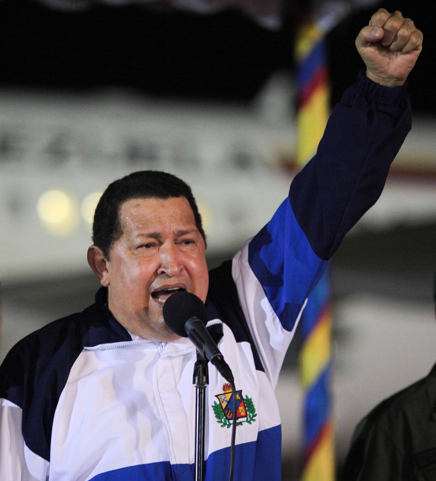 Photo -   In this photo released by Miraflores Press Office, Venezuela's President Hugo Chavez gives a speech upon his arrival to Simon Bolivar international airport in Maiquetia near Caracas, Venezuela, late Friday, May 11, 2012. Chavez returned to Venezuela after traveling to Cuba in late April for further cancer treatment. (AP Photo/Miraflores Press Office, Efrain Gonzalez)