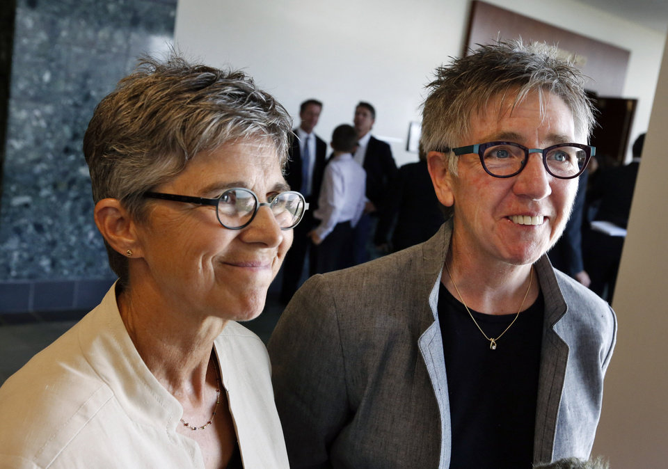 """Photo - File - In this June 16, 2014, file photo, plaintiffs in a gay-marriage case and longtime couple Rebecca Brinkman, left, and Margaret Burd take questions from members of the media following a hearing at Adams County District Court, in Brighton, Colo. A Colorado judge on Wednesday July 9, 2014 struck down the state's gay marriage ban, making him the 16th judge to invalidate a state's prohibition on same-sex marriages in the past year. District Judge C. Scott Crabtree put his ruling on hold pending an appeal, but wrote that the provisions in Colorado law clearly violate the state and U.S. constitutions. """"There is no rational relationship between any legitimate governmental purpose and the marriage bans,"""" he wrote. (AP Photo/Brennan Linsley, File)"""
