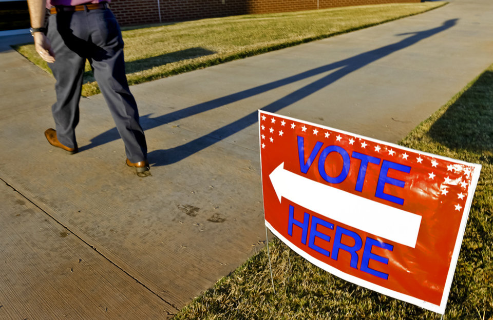 Photo - A voter walks into the precinct to vote during election day on Tuesday, Nov. 6, 2012, in Yukon, Oklahoma. Photo by Chris Landsberger, The Oklahoman