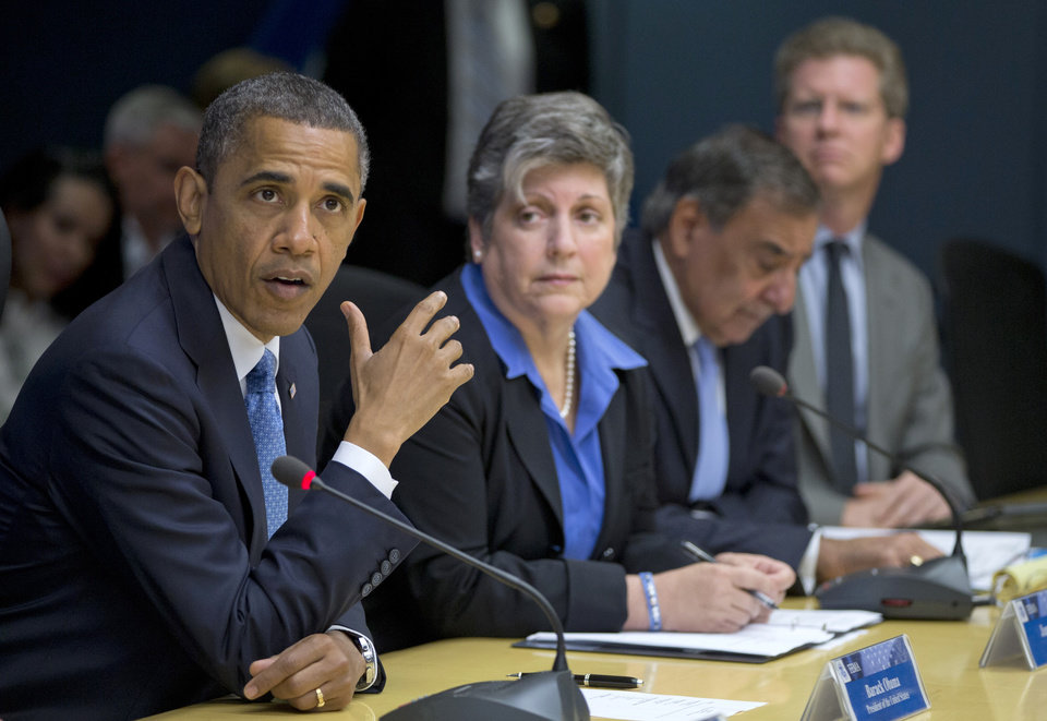 FILE - In this Oct. 31, 2012 file photo, President Barack Obama, accompanied by members of his Cabinet, speaks at the Federal Emergency Management Agency (FEMA) Headquarters in Washington to discuss Superstorm Sandy. From second left are Homeland Security Secretary Janet Napolitano, Defense Secretary Leon Panetta, and Housing and Urban Development (HUD) Secretary Shaun Donovan. Obama on Friday, Dec. 7, 2012 asked Congress for $60.4 billion in federal aid for New York, New Jersey and other states hit by Superstorm Sandy in late October. It's a disaster whose cost is rivaled only by the Sept. 11, 2001 terrorist attacks and the 2005 Hurricane that devastated New Orleans and the Gulf Coast. (AP Photo/Carolyn Kaster, File)