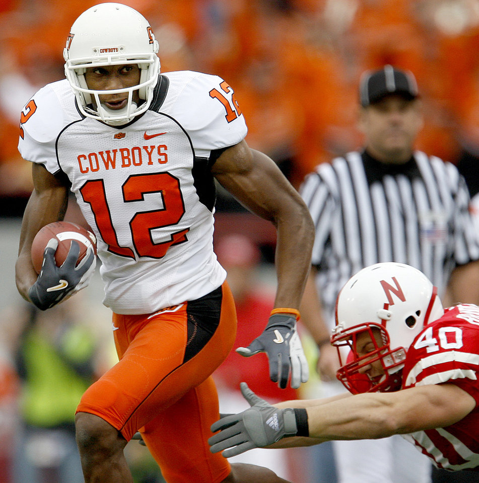 Photo - Adarius Bowman of OSU runs past Lance Brandenburgh of Nebraska during  the college football game between Oklahoma State University (OSU) and the University of Nebraska at Memorial Stadium in Lincoln, Neb., on Saturday, Oct. 13, 2007. By Bryan Terry, The Oklahoman