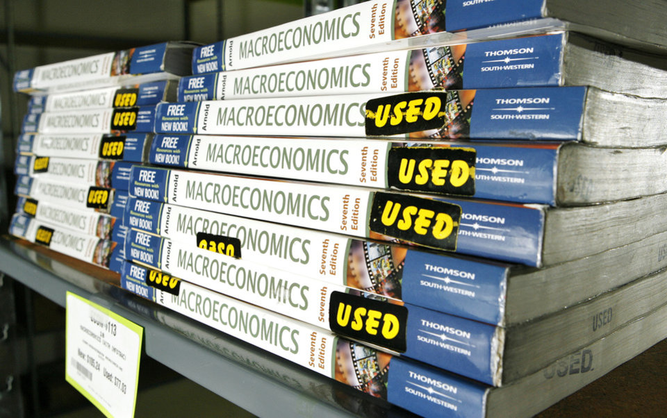 Beat the Bookstore, a new book store in Norman offers values on text books for University of Oklahoma students. Photos taken Monday, Aug. 28, 2006. Used macroeconmics textbooks are stacked on a shelf in the store. By Jim Beckel /The Oklahoman
