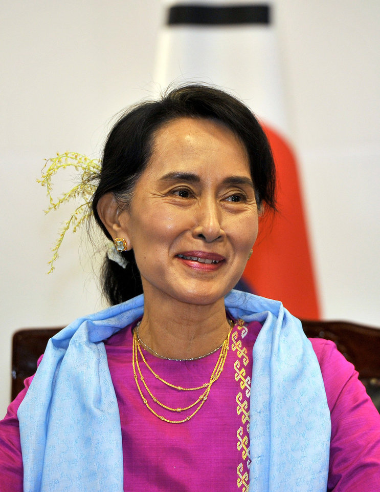 Photo - Myanmar opposition leader Aung San Suu Kyi talks during a meeting with South Korean President-elect Park Geun-hye in Seoul on Tuesday, Jan. 29, 2013. (AP Photo/Jung Yeon-je, Pool)