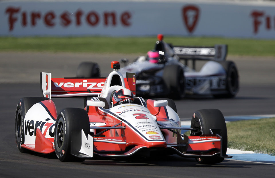 Photo - Juan Pablo Montoya, of Colombia, leads Franck Montagny, of France, through turn 2 during practice for the inaugural Grand Prix of Indianapolis IndyCar auto race at the Indianapolis Motor Speedway in Indianapolis, Thursday, May 8, 2014. (AP Photo/Michael Conroy)