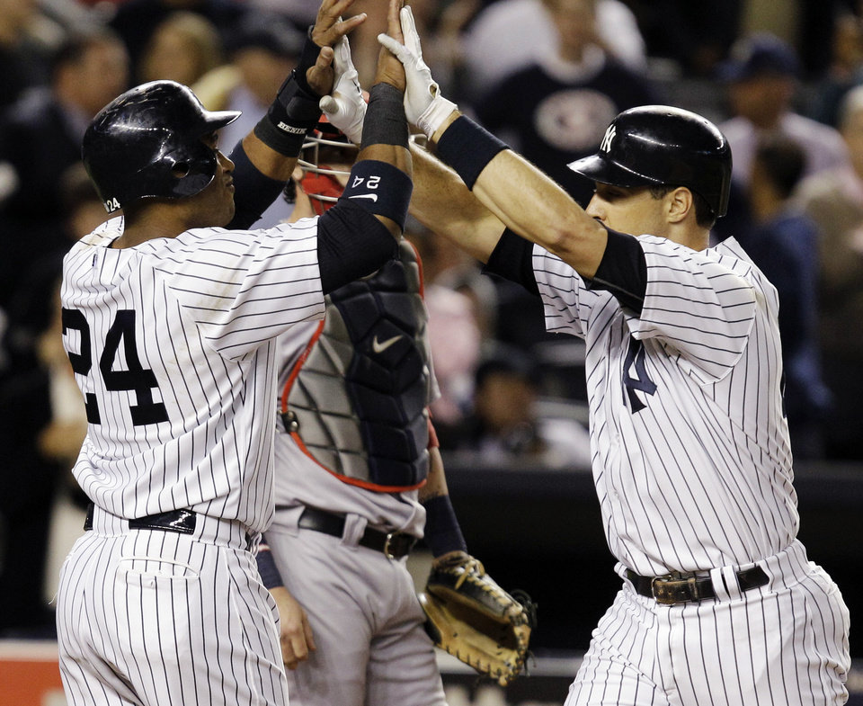 Photo -   New York Yankees' Robinson Cano (24) greets Mark Teixeira at the plate after Texieira hit a second-inning, solo home run off Boston Red Sox reliever Alfredo Aceves during their baseball game at Yankee Stadium in New York, Monday, Oct. 1, 2012. (AP Photo/Kathy Willens)