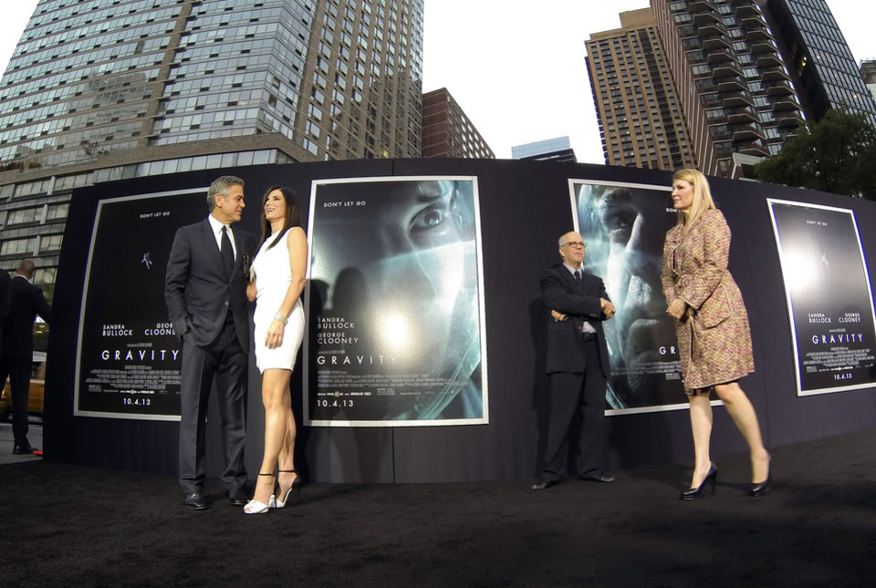 "Photo - Actors George Clooney and Sandra Bullock arrive at the premiere of ""Gravity"" at the AMC Lincoln Square Theaters on Tuesday, Oct. 1, 2013, in New York. (Photo by Evan Agostini/Invision/AP) ORG XMIT: NYEA137"