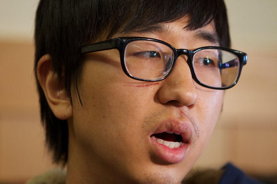 Photo - Jaemin Seo, 23, a Korean student from Vancouver, B.C., speaks Monday Dec. 31, 2012, in Pendleton, Ore., about waking up to people screaming and then being thrown from a  bus that crashed in rural Eastern Oregon, Sunday. The crash killed nine and sent multiple people, including Seo, to hospitals. He was injured in his arm and leg. (AP Photo/The Oregonian, Randy L. Rasmussen)