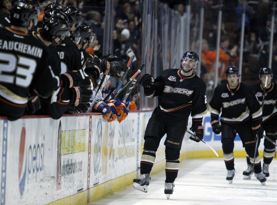 Photo - Anaheim Ducks right wing Kyle Palmieri, center, celebrates with his bench after scoring during the first period of an NHL hockey game against the Edmonton Oilers, Friday, Jan. 3, 2014, in Los Angeles.  (AP Photo/Alex Gallardo)