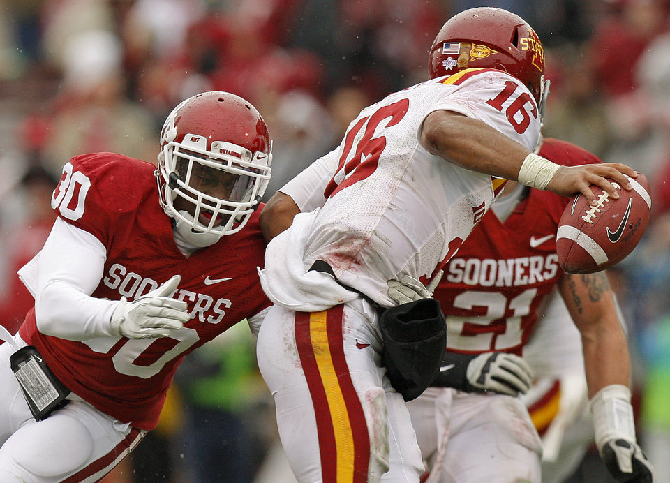 Oklahoma\'s Javon Harris (30) goes after Iowa State\'s Jared Barnett (16) during a college football game between the University of Oklahoma Sooners (OU) and the Iowa State University Cyclones (ISU) at Gaylord Family-Oklahoma Memorial Stadium in Norman, Okla., Saturday, Nov. 26, 2011. Photo by Bryan Terry, The Oklahoman