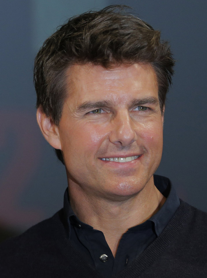 FILE - In this Jan. 9, 2013 file photo, US actor Tom Cruise poses for photographers during a news conference of his film