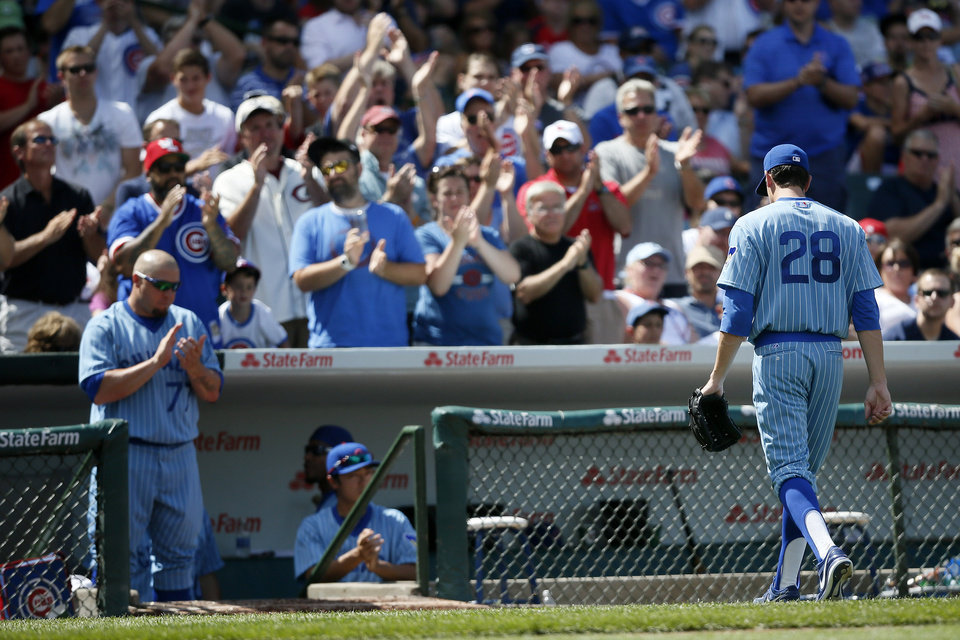 Photo - Chicago Cubs starting pitcher Kyle Hendricks heads to the dugout after being relieved during the seventh inning of a baseball game against the St. Louis Cardinals on Sunday, July 27, 2014, in Chicago. (AP Photo/Andrew A. Nelles)
