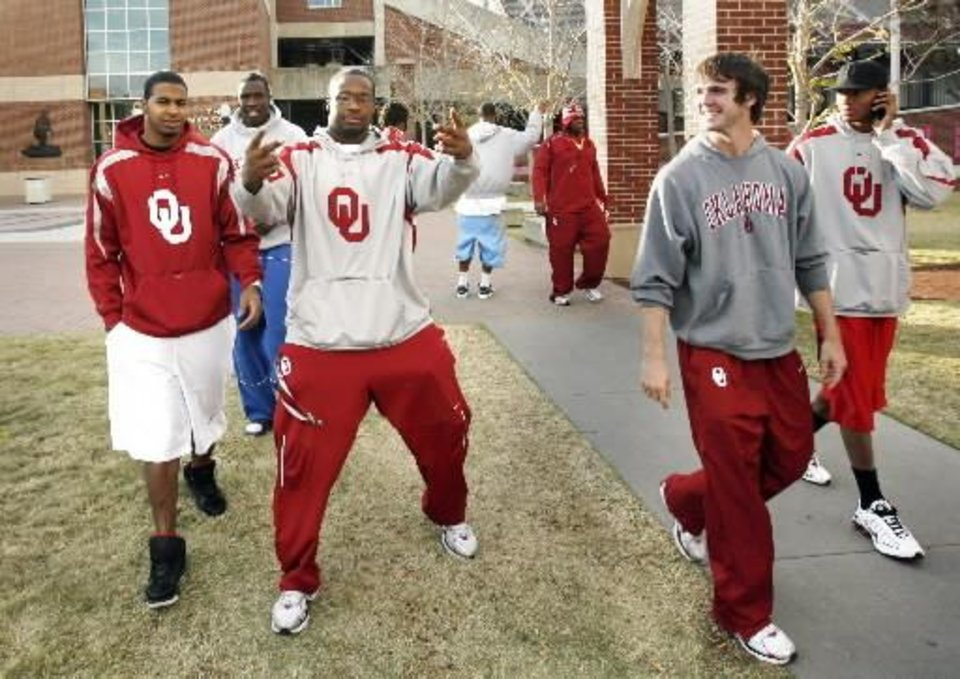 University of Oklahoma football players including Gerald McCoy (gesturing) and Joey Halzle (second from right) leave the Switzer Center after watching results of the Bowl Championship Series ranking in Norman, Oklahoma on Sunday, November 30, 2008. By Steve Sisney